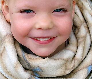 Lilly huddled in blanket