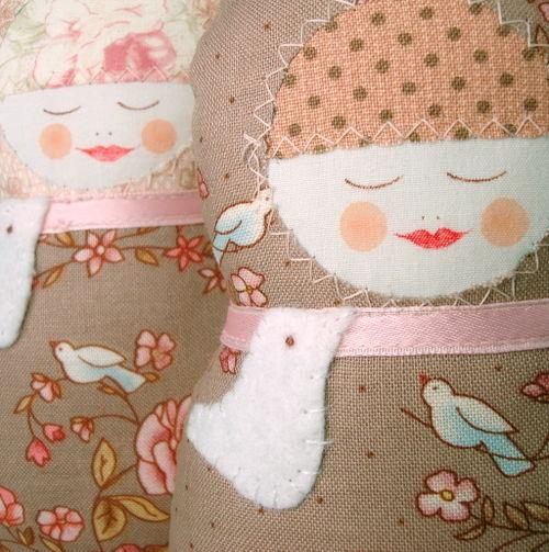 2 sleeping pink with birds