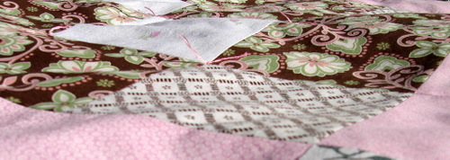Long_view_brown_and_pink_quilt